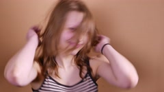 Emotional happy teenager girl make funny faces, dancing and having fun Arkistovideo