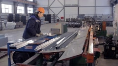 Worker is packing metal beams Stock Footage