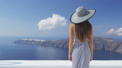 Travel vacation woman looking at Santorini view - famous tourist destination Stock Footage