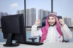 Successful Arabian businessman in office Stock Photos