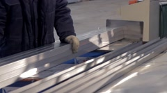 Worker is packing metal beams close-up Stock Footage