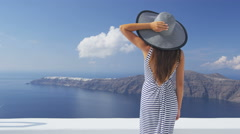 Vacation woman luxury travel looking at Santorini - famous tourist destination Stock Footage