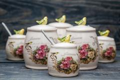 Ceramic Round Jars with Flower Ornaments and Birds Stock Photos