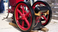 Rotating flywheels of retro steam engine at old cars exhibition, old machinery - stock footage