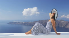 Santorini Greece Europe travel vacation - Woman looking at view of Caldere Stock Footage