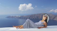 Europe Greece Santorini travel vacation - woman relaxing enjoying luxury - stock footage