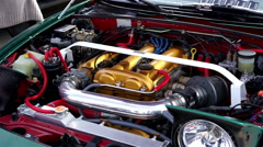 Engine and other parts under hood of vintage sports car, mechanics, maintenance Stock Footage
