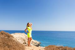 Pretty girl stay on the top of  mountain and see to  horizon with beautiful Stock Photos