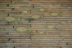 The wall covered with fish wooden art work Stock Photos