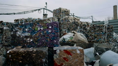 Piles Of Scrap Metal Bundled in Bales for Recycling - stock footage