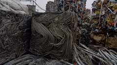 Piles Of Scrap Metal And Strip Bundled in Bales Stock Footage