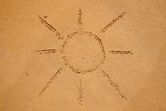 Sun Drawn in the Sand on Beach Stock Photos