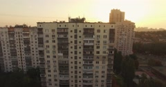 Aerial establishing shot of dormitory/residential area at sunrise Stock Footage