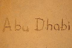 Abu dhabi written in the sand Stock Photos