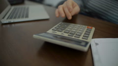 Man Punching Numbers into a Calculator - stock footage