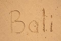 word Bali outline on the wet sand  - holiday concept - stock photo