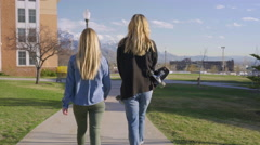 Friends Go For A Walk On School Campus, Girl Carries Her Skateboard Stock Footage