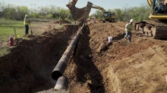 Construction crews work to remove an oil pipeline Stock Footage