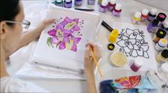 Batik Process: Artist paints on Fabric, Batik-making. Stock Footage