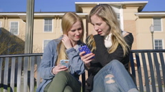 Friends Show Each Other Things On Their Smart Phones - stock footage