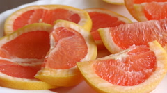 Panorama View Of Grapefruit Slices On The White Plate Stock Footage