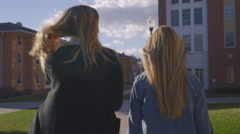 Girls Get Up From Bench, Put Smart Phones Away, And Walk Around Campus - stock footage