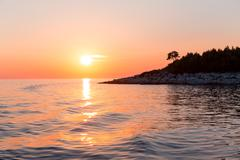 Sea sunset with ship trace Stock Photos