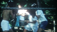3249 boys boxing in outdoor ring at training camp - vintage film home movie Stock Footage