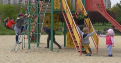May Day in Opole Kids Climbing up the Cute Ropes on Playground Parents Are Stock Footage