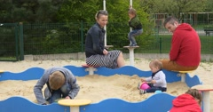 May Day in Opole Family at the Sandbox Mom Dad Parents Look After Kids on Stock Footage