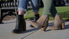 Closeup Of Feet, Camera Tilts Up To Students Using A Tablet And A Smartphone Stock Footage