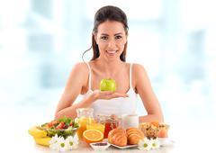 Young woman having breakfast. Balanced diet. - stock photo