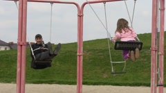 May Day Opole Poland Girl and Father on Swings Playground Adult Man is Swinging Stock Footage