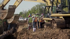 Large construction crew works on an oil pipeline Stock Footage