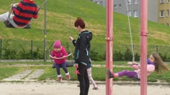 May Day Opole Mom Pulls and Pushes Kid on Swing Playground Little Kids Are Stock Footage