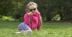Emotions of the Child Lying on the Lawn Stock Footage