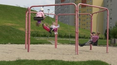 May Day in Opole Poland Little Girls Are Swinging on Swings Dad Adult Man is Stock Footage