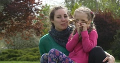 Mom and Daughter in the Park Stock Footage