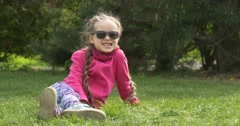 Girl on the Grass Hamming. Stock Footage