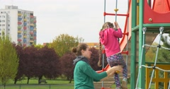 Mother and Daughter on the Playground Stock Footage
