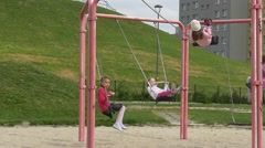May Day in Opole Little Girls on Swings Playground Dad Adult Man is Swinging Stock Footage