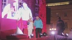 Egorova and Poltavchenko ignite Sochi Olympic bowl on stage in Saint Petersburg - stock footage