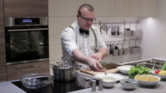 The man cut the fish into steaks Stock Footage