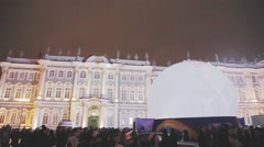 Relay race of Sochi Olympic flame in Saint Petersburg. Crowded Palace Square Stock Footage