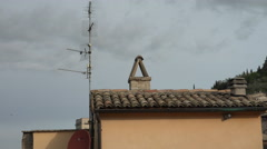 Stone Chimney, terracotta roofs,  Medieval Assisi, Italy - stock footage