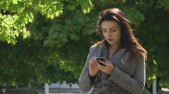 Girl iPhone to listen to wait Stock Footage