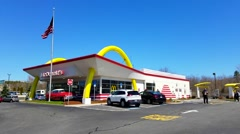 McDonalds fast food restaurant, us flag Stock Footage