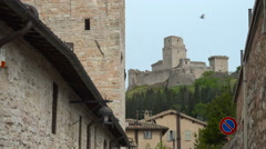 Castle Rocca Maggiore seen from Medieval Assisi street Stock Footage