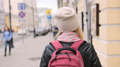 Pretty young woman tourist walk the streets of Moscow Stock Footage