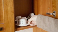 Kitchen cabinet small cups picking Stock Footage